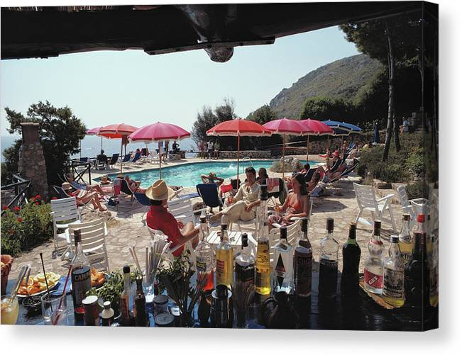 1980-1989 Canvas Print featuring the photograph Poolside Bar by Slim Aarons