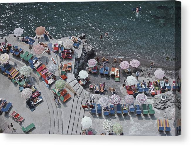 Curve Canvas Print featuring the photograph Positano Beach by Slim Aarons