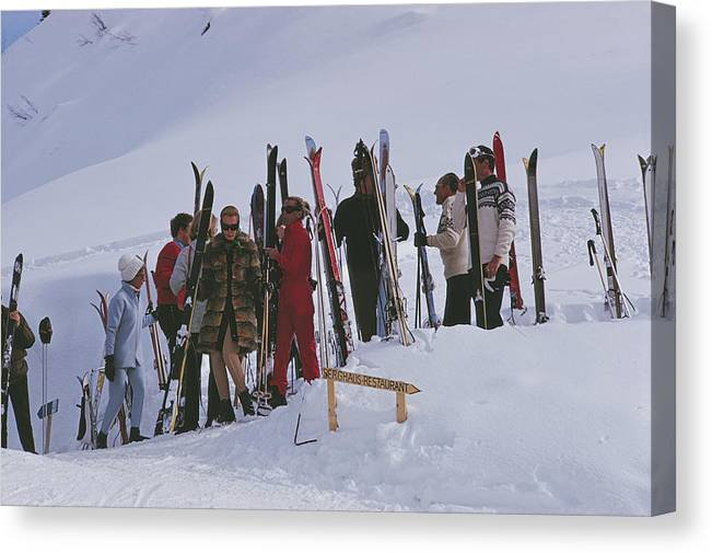 Gstaad Canvas Print featuring the photograph Skiers At Gstaad by Slim Aarons