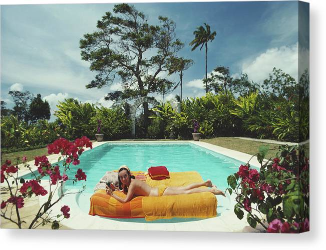 Artist Canvas Print featuring the photograph Sunbathing In Barbados by Slim Aarons