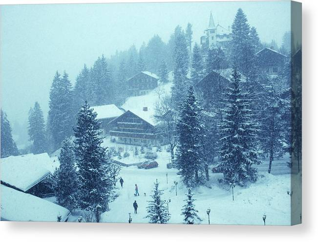 Gstaad Canvas Print featuring the photograph Winter In Gstaad by Slim Aarons