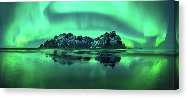 Photography Canvas Print featuring the photograph Reflection Of Aurora Borealis by Panoramic Images
