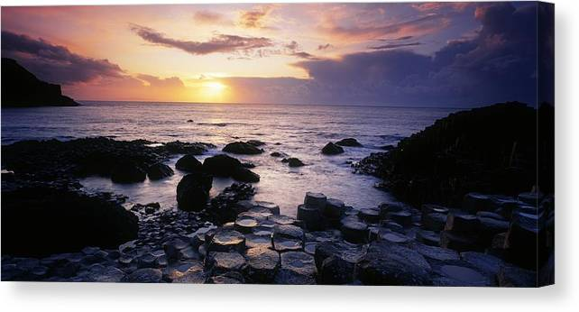 Basalt Canvas Print featuring the photograph Rocks On The Beach, Giants Causeway by The Irish Image Collection