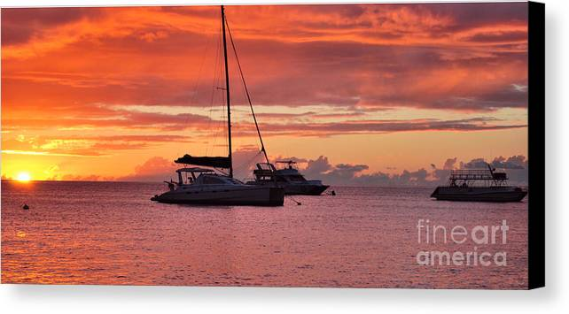 Sunsets Canvas Print featuring the photograph Tropical Sunset by Josiah St Jean