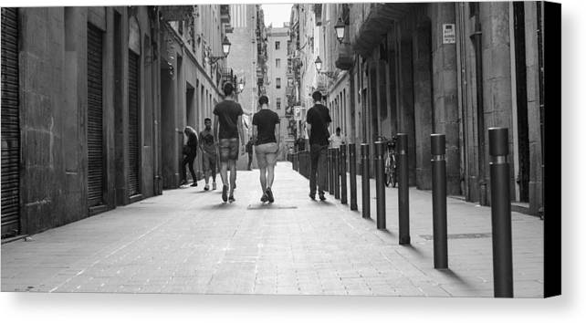 Walking Canvas Print featuring the photograph Walking In Barcelona by Victor Vega
