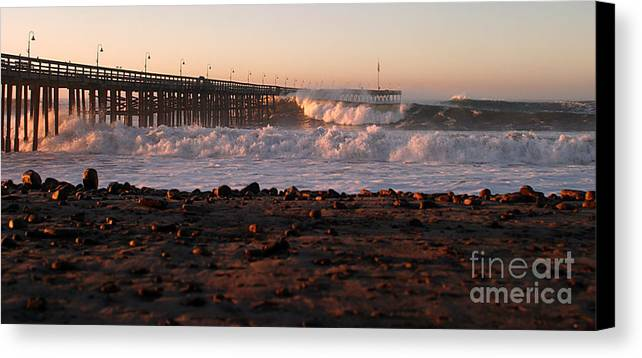 Storm Canvas Print featuring the photograph Ocean Wave Storm Pier by Henrik Lehnerer
