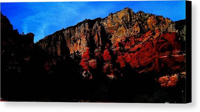 Red Rock Canvas Print featuring the photograph Scarlet Cliffs by Annie Terrence