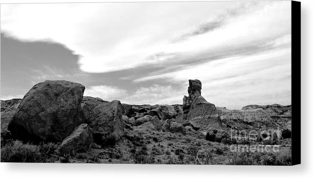 Landscape Canvas Print featuring the photograph Cloudswept Bisti Spire by Chad Bennett