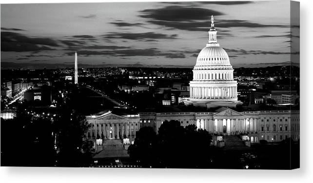 Photography Canvas Print featuring the photograph High Angle View Of A City Lit by Panoramic Images