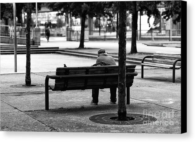 Alone In The Park Canvas Print featuring the photograph Alone In The Park Mono by John Rizzuto