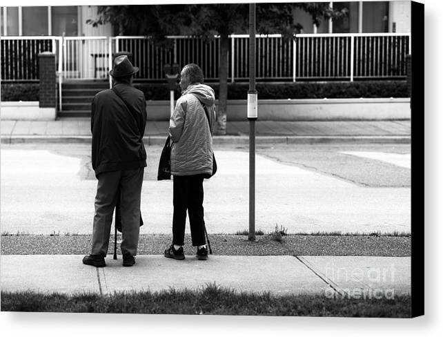 Waiting For The Bus Canvas Print featuring the photograph Waiting For The Bus by John Rizzuto