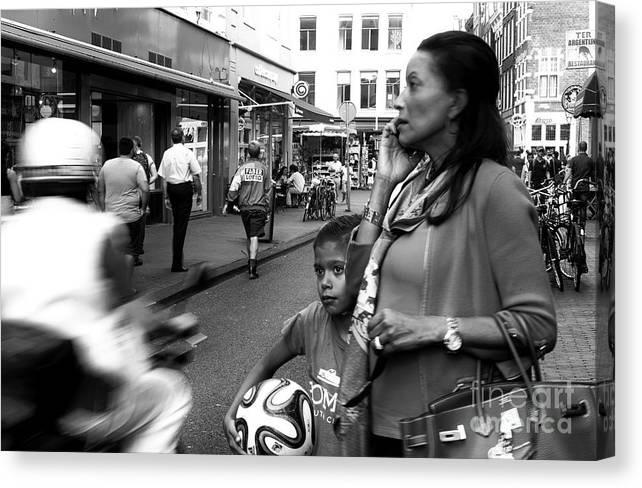 Crossing The Street Canvas Print featuring the photograph Crossing The Street Mono by John Rizzuto
