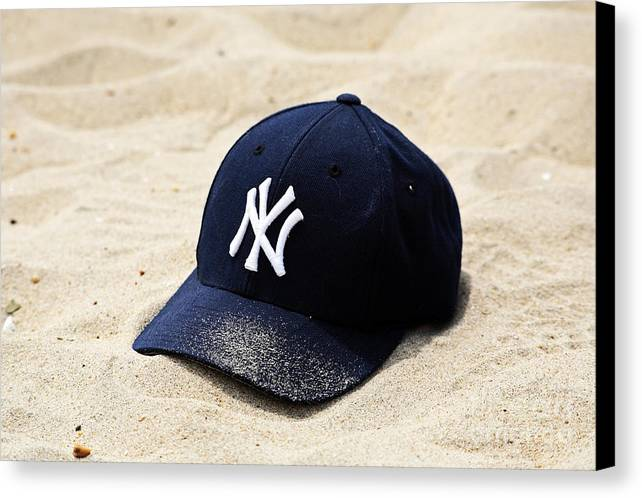 Beach Cap Canvas Print featuring the photograph Beach Cap by John Rizzuto