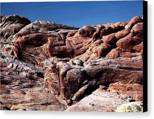 Fire Rocks Canvas Print featuring the photograph Fire Rocks by John Rizzuto