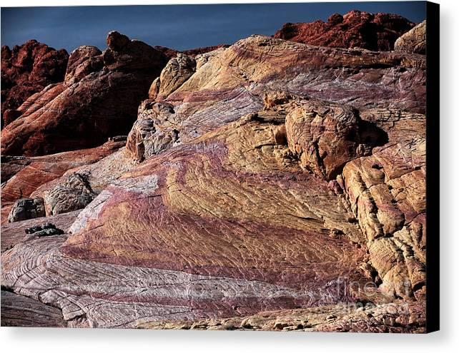 Purple Rocks Canvas Print featuring the photograph Purple Rocks by John Rizzuto