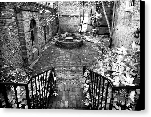 The Courtyard At The Old North Church Canvas Print featuring the photograph The Courtyard At The Old North Church by John Rizzuto
