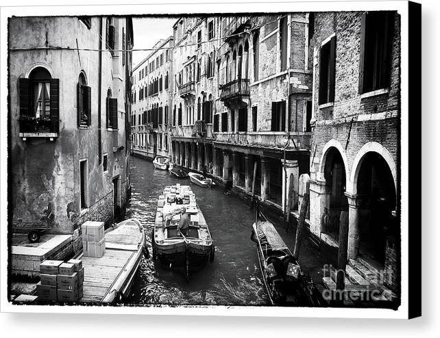 Working On The Canal Canvas Print featuring the photograph Working On The Canal by John Rizzuto