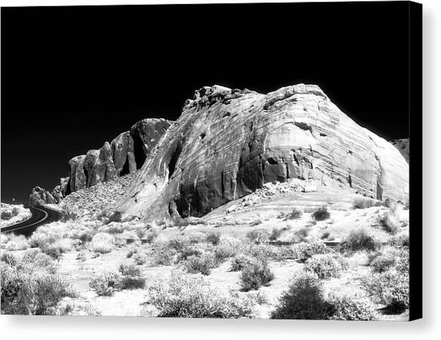 Desert Rock Canvas Print featuring the photograph Desert Rock by John Rizzuto