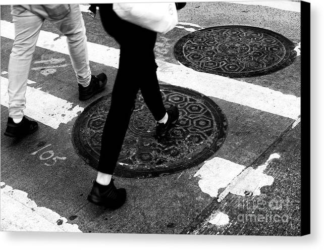 Crossings Canvas Print featuring the photograph Crossings Manhole Covers by John Rizzuto