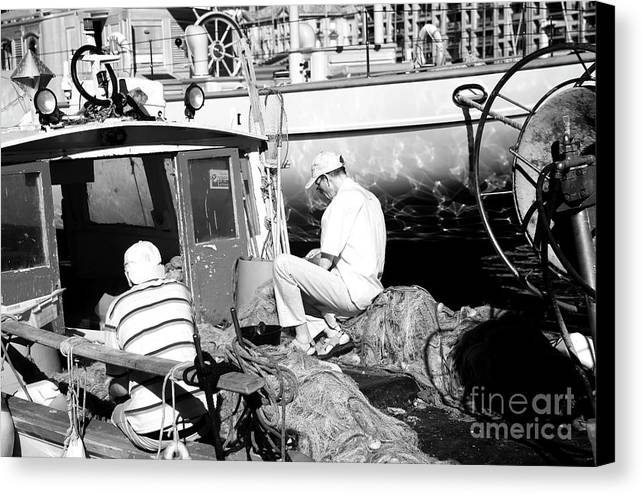 Fisherman Canvas Print featuring the photograph Fisherman by John Rizzuto