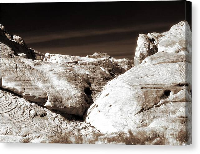 Landing In The Desert Canvas Print featuring the photograph Landing In The Desert by John Rizzuto