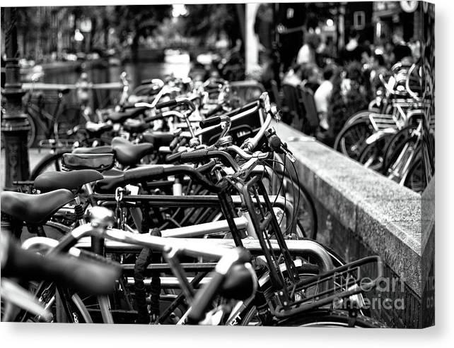 Bike Row Canvas Print featuring the photograph Bike Row Mono by John Rizzuto