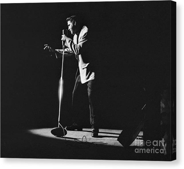 Elvis Presley Canvas Print featuring the photograph Elvis Presley on stage in Detroit 1956 by The Harrington Collection