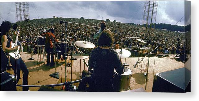 Timeincown Canvas Print featuring the photograph Santana Onstage At Woodstock by Bill Eppridge