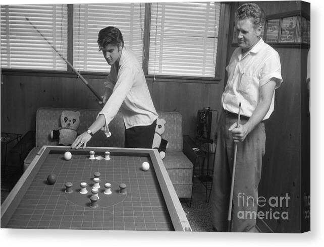 Elvis Presley Canvas Print featuring the photograph Elvis Presley and Vernon Playing Bumper Pool 1956 by The Harrington Collection
