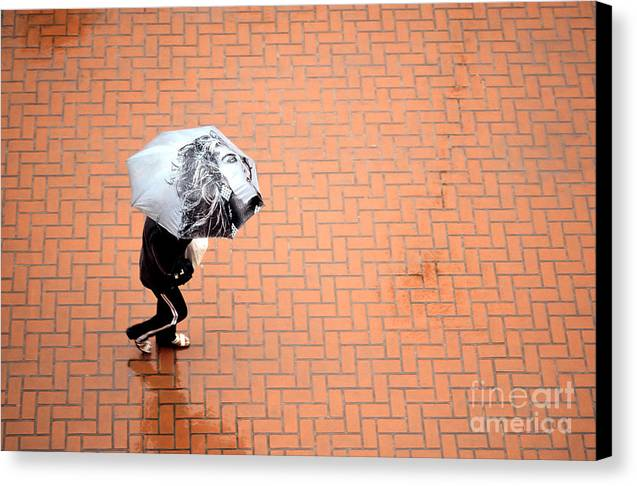 East Canvas Print featuring the photograph Going East- Umbrellas Series 1 by Carlos Alvim