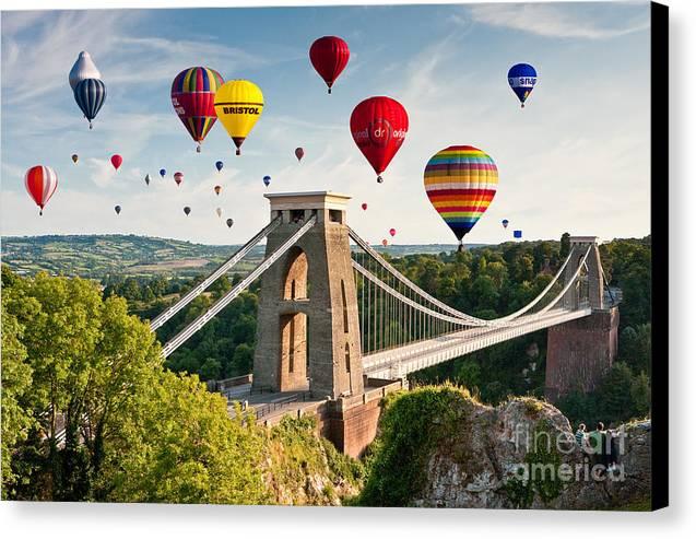 Bristol balloon fiesta display over clifton suspension bridge canvas ashton court canvas print featuring the photograph bristol balloon fiesta display over clifton suspension bridge by reheart Images