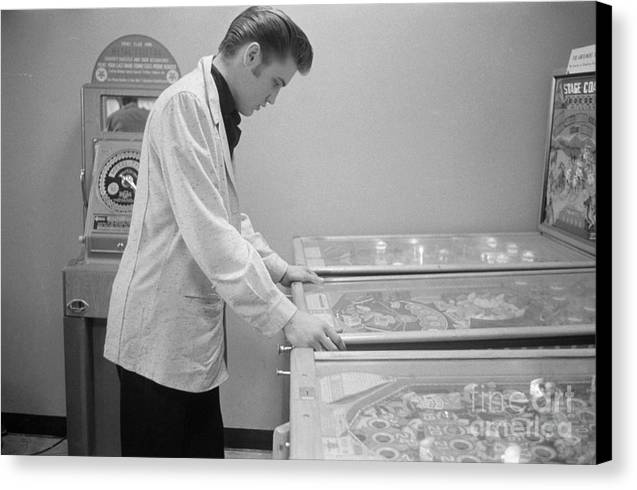 Elvis Presley playing Pinball 1956 by The Harrington Collection