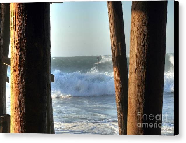Malibu Canvas Print featuring the photograph Pylon Surfer by Richard Omura