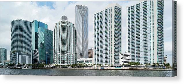 Photography Canvas Print featuring the photograph Skyscrapers At The Waterfront by Panoramic Images