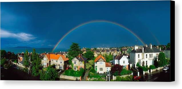 Atmosphere Canvas Print featuring the photograph Rainbow Over Housing, Monkstown, Co by The Irish Image Collection