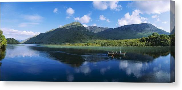Co Galway Canvas Print featuring the photograph Three People On A Boat In The Lake by The Irish Image Collection
