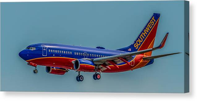 Plane Canvas Print featuring the photograph Southwest 737 Landing by Paul Freidlund