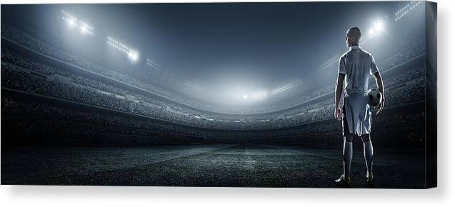 Soccer Uniform Canvas Print featuring the photograph Soccer Player With Ball In Stadium by Dmytro Aksonov