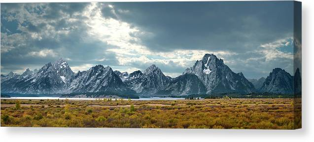Scenics Canvas Print featuring the photograph Grand Tetons In Dramatic Light by Ed Freeman