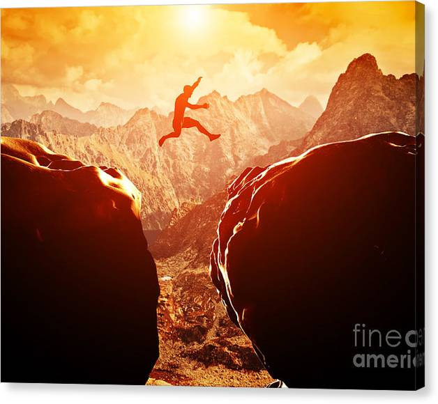 Limited Time Promotion: Man Jumping Over Precipice In Mountains Stretched Canvas Print