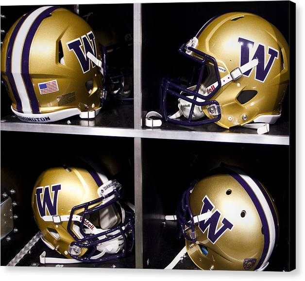 Replay Photos Canvas Print featuring the photograph Washington Huskies Football Helmets by Replay Photos