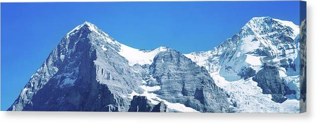 Photography Canvas Print featuring the photograph Scenic View Of Eiger And Monch Mountain by Panoramic Images