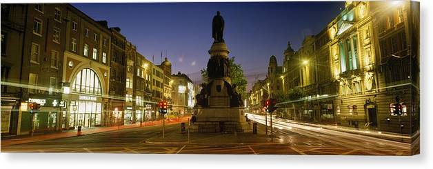 Baile �tha Cliath Canvas Print featuring the photograph Statue Of A Man On A Pedestal On The by The Irish Image Collection