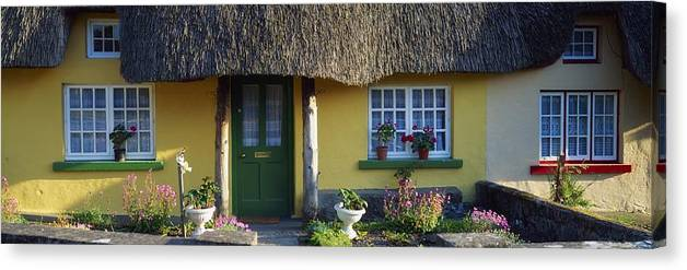 Architecture Canvas Print featuring the photograph Thatched Cottage, Adare, Co Limerick by The Irish Image Collection