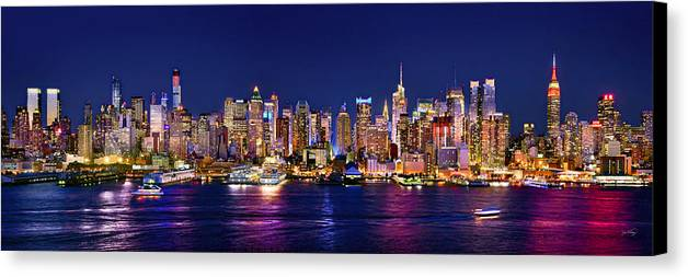 New York City Skyline At Night Canvas Print featuring the photograph New York City Nyc Midtown Manhattan At Night by Jon Holiday