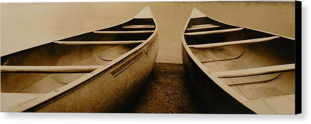 Canoes Canvas Print featuring the photograph Two Canoes by Jack Paolini