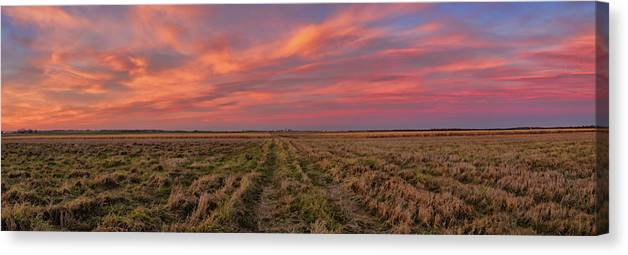 Photography Canvas Print featuring the photograph Clouds Over Landscape At Sunset by Panoramic Images