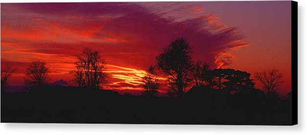 Sunset Canvas Print featuring the photograph 022107-37 by Mike Davis