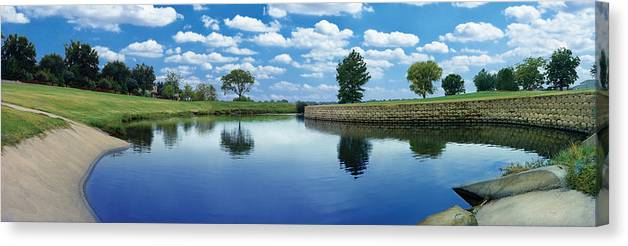 Clouds Canvas Print featuring the photograph Lakeridge Duck Pond by Robert Hudnall