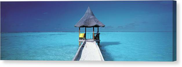 Tranquility Canvas Print featuring the photograph Pier And Blue Indian Ocean, Maldives by Peter Adams